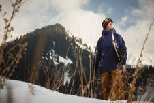Free Low Angle Photography Of Man Wearing Blue Jacket Carrying Snow Board Stock Images - 109927914