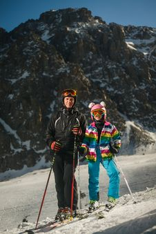 Free Man And Woman Wearing Snow Ski Suit And Snow Ski With Poles During Snow Royalty Free Stock Photography - 109928007