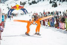 Free Photography Of Men In Orange Suits Ridding Snowboard Stock Image - 109928141