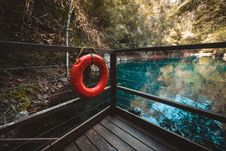 Free Red Life Buoy Hanging On Brown Wooden Balcony Stock Photo - 109928280