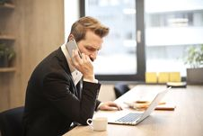 Free Man Having A Phone Call In-front Of A Laptop Stock Photos - 109928283