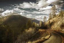 Free Curved Asphalt Road Between Mountains Stock Photos - 109928393