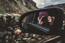 Free Person Holding Dslr Camera Reflected On Black Framed Wing Mirror Stock Photography - 109928442