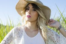 Free Woman Wearing Brown Hat And White Cardigan Standing In Middle Of Grass Field Stock Photos - 109928453