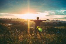 Free Person Spreading Hands Against Sun Stock Image - 109928491