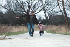 Free Man And Girl Running On Asphalt Road Stock Photos - 109928493
