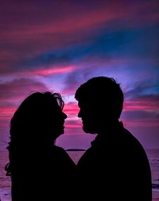 Free Silhouette Of Couple Facing Each Other Royalty Free Stock Photo - 109928525