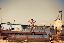 Free Woman Standing On Brown Steel Container Wearing Two-piece Bikini Royalty Free Stock Photo - 109928535