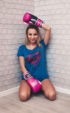 Free Woman Wearing Blue Crew-neck Shirt And Pink Boxing Gloves Stock Photography - 109928552
