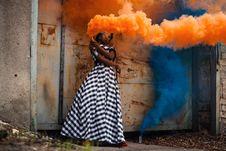 Free Woman In White And Black Dress Holding Orange Smoke Stock Photo - 109928590