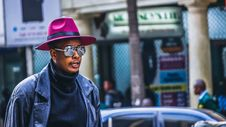 Free Man Wearing Purple Hat And Black Leather Jacket Royalty Free Stock Images - 109928789