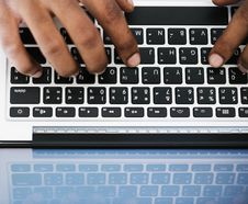 Free Person Typing On White And Black Laptop Computer Stock Photos - 109928903