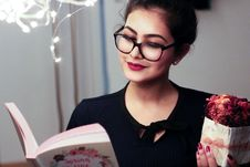 Free Woman Holding Book Stock Photo - 109929000