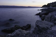 Free Photo Of Calm Body Of Water Beside Rock Formations Royalty Free Stock Photo - 109929125