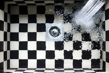 Free Water Flowing On White And Black Checked Bath Tub Royalty Free Stock Photos - 109929158