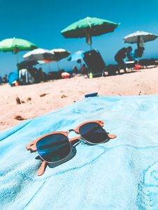 Free Brown Clubmaster Sunglasses On Blue Towel Stock Photos - 109929253