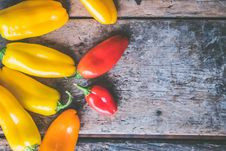 Free Yellow, Orange, And Red Peppers On Wooden Surface Royalty Free Stock Photography - 109929887
