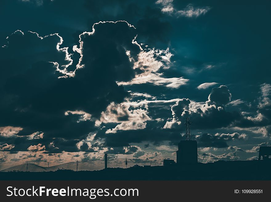 Silhouette of Building Under Cloudy Blue Sky