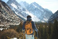 Free Men S Blue Leather Jacket And Brown Backpack Stock Photos - 109973243