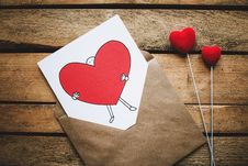 Free White, Black, And Red Person Carrying Heart Illustration In Brown Envelope Stock Photos - 109973273