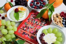 Free Fruits On Plates Beside Red Book Stock Images - 109973284