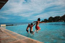 Free Three Boy S Jumping Into The Water Stock Images - 109973294