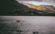 Free Person Kayaking On Body Of Water Royalty Free Stock Image - 109973346