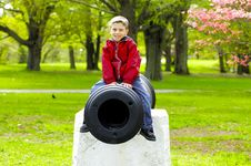 Free Child Sitting On Cannon Stock Photo - 119230