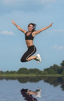 Free Woman Jumping Above Water Royalty Free Stock Photos - 1100068