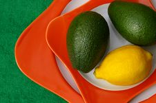 Lemon And Avocado Stock Images