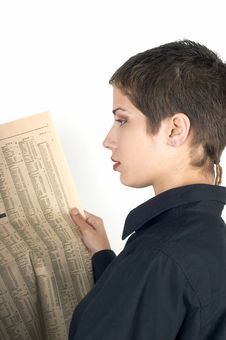 Free Girl Reading A Newspaper Royalty Free Stock Photo - 1107705