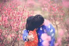 Free Man Hugging Girl In Orange Clothes Royalty Free Stock Photos - 110047028