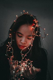 Free Woman Wears Black Long-sleeved Shirt Hold String Lights Royalty Free Stock Image - 110174296