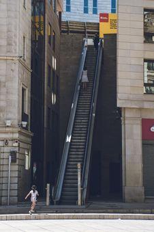 Free Girl Walking Towards The Escalator Stock Photos - 110174363