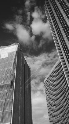 Free Low Angle Grayscale Photography Of Buildings And Clouds Stock Images - 110174394