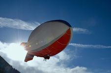 Free White And Red Blimp Flying Royalty Free Stock Image - 110174436