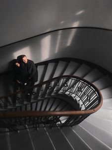 Free Woman And Man Standing On Stairs Stock Photos - 110248473