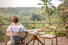 Free Brown-haired Woman Sitting On Brown Wooden Chair On Patio Royalty Free Stock Photos - 110248558