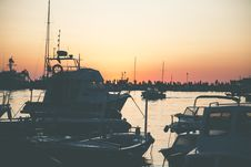 Free Several Boats On Calm Water During Golden Hour Royalty Free Stock Images - 110248579