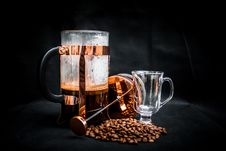 Free Coffee Beans Beside Coffee Press And Glass Cup Stock Photo - 110341910