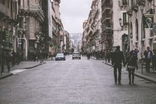 Free Holding Hand Couple Walking In Street Between Building Royalty Free Stock Image - 110341936