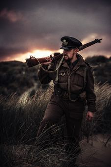 Free Photo Of A Man Holding A Gun Stock Images - 110341964