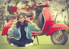 Free Girl Doing Peace Sign Indian Sitting In Front Of Red Scooter Motorcycle Royalty Free Stock Photo - 110418095