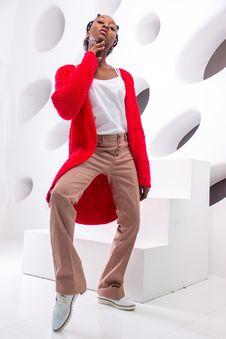 Free Woman Wearing Shirt, Red Cardigan, Beige Dress Pants Royalty Free Stock Photography - 110418137