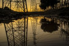 Free Silhouette Of Trees And Electric Tower Reflecting On Body Of Water During Sunset Stock Photos - 110501053