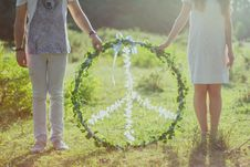Free Two Person Holding White And Green Peace Wreath Stock Photo - 110535050