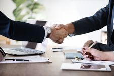Free Two Person In Formal Attire Doing Shakehands Stock Image - 110654921