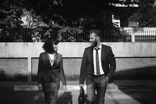 Free Grayscale Photo Of Man And Woman In Formal Suits Royalty Free Stock Photography - 110654927