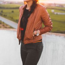 Free Woman Wearing Brown Leather Jacket And Black Pants Royalty Free Stock Image - 110654946