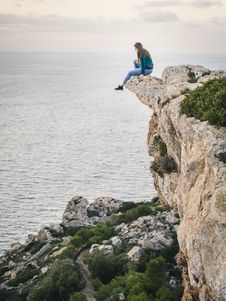 Free Woman Sitting On Mountain Stock Images - 110654964